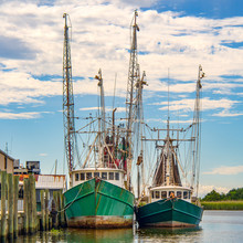 Shrimp Fishing Boats Docked On River In Apalachicola Florida