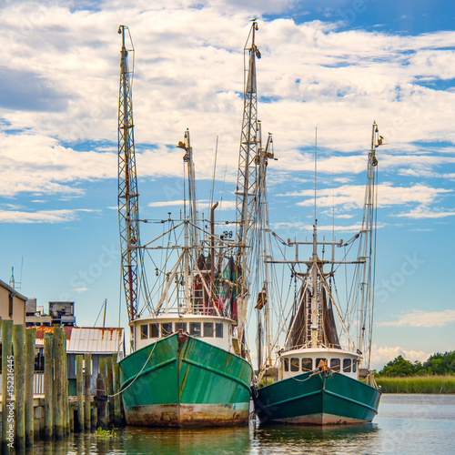Shrimp fishing boats docked on river in Apalachicola Florida