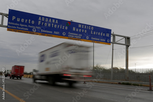 Trucks travel to border customs control before cross into