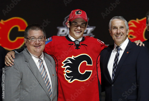 Sean Monahan Poses With Calgary Flames Executives After Being