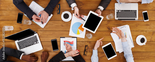 Obraz Group of busy business people meeting in office, top view - fototapety do salonu