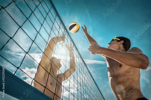 Beach Volleyball players in sunglasses under sunlight. Dynamic s