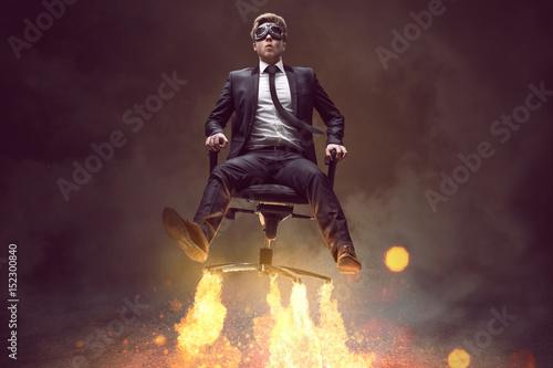 Mann auf Bürostuhl mit Raketenantrieb Canvas Print