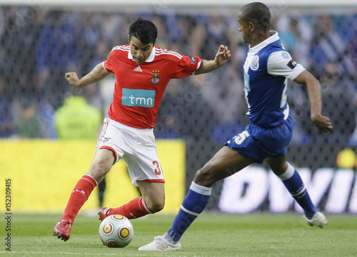 Porto s Fernando battles for the ball with Benfica s Saviola during their  Portuguese Premier League soccer match in Porto. By Miguel Vidal   REUTERS f2432c08f7369