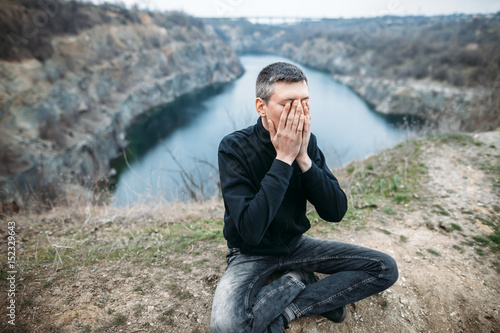 Fotografie, Obraz  Portrait of stressed despair man closed face by two hands