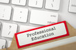 Professional Education. Red Folder Register on Background of White Modern Computer Keyboard. Archive Concept. Closeup View. Blurred Image. 3D Rendering.