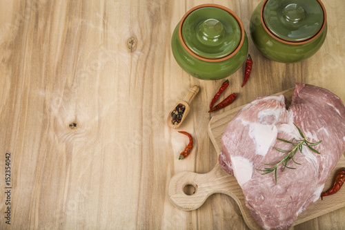 Fototapety, obrazy: Pork and pots on the table. Cooking.
