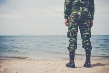 The Soldiers Stood At The Beach And Looked Out To Sea.
