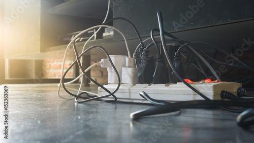 Obraz Plug the power plug, Multiple socket with connected plugs. - fototapety do salonu
