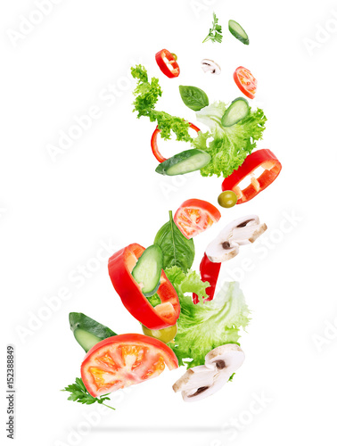 flying salad isolated on wooden background.