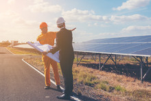 Engineer And Foreman Discussing Construction Project Solar Power Plant