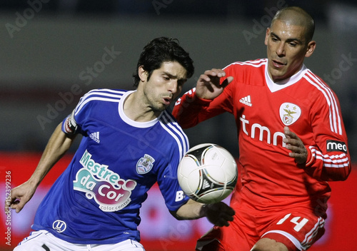 CD Feirense s Diogo battles for the ball with Benfica s Maxi during their  Portuguese Premier League soccer match in Santa Maria da Feira 4234bae4d4123