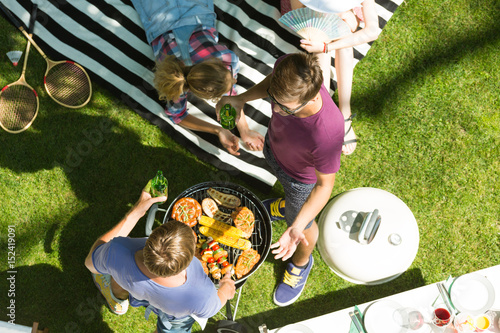 Photo Stands Grill / Barbecue Men grilling the food