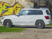 Beautiful White Car Near Multi-colored Wall
