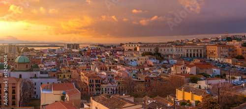 Fotografie, Obraz  Wide angle panorama of Cagliari old city center during the sunset, dramatic sky