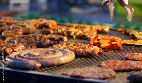 Foto op Plexiglas Grill / Barbecue Grilled meat on a hot grill.