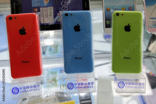 Apple's iPhone 5Cs are displayed on racks bearing the logo of China