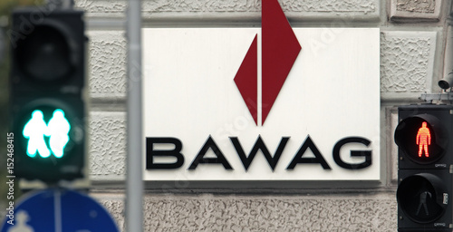 The Logo Of Austrian Bawag Psk Bank Is Pictured Behind A Traffic