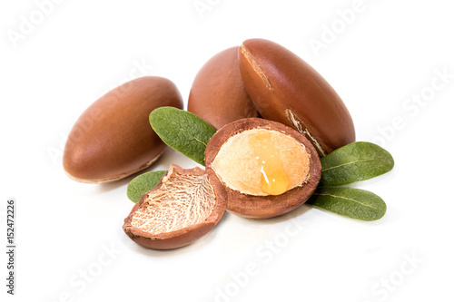 Argan nuts, with interior detail and oil drop