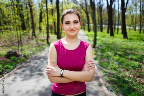 Fotografija  Young pretty fit woman respiting after jogging in the park