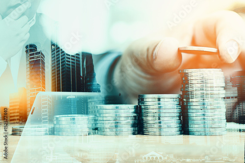 Fototapeta Double Exposure of  Businessman Put Coins To Stack Of Coins.  Saving money concept obraz