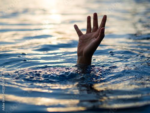Fotografija Drowning victims, Hand of drowning man needing help