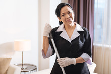 Delighted Positive Chambermaid Looking At You