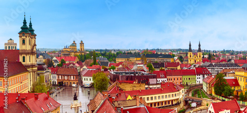 Fotografia  Panoramic view of Eger city, Hungary with red roofs and blue sky