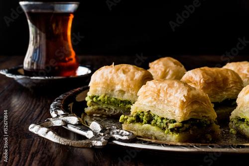 Turkish Dessert Baklava with tea on silver tray. Wallpaper Mural