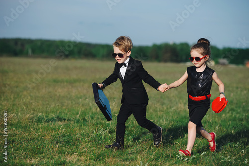 фотография  young boy and girl playing spy