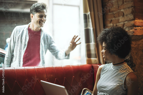 Photo  Man greeting girl in window