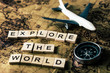 canvas print picture - Explore the world concept on vintage map with compass and airplane
