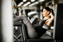 Young Woman Exercise Abs At Th...