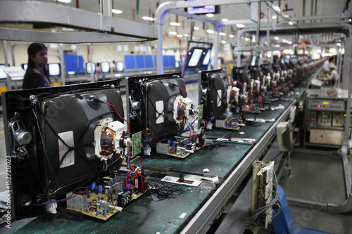 36060391f A worker at LG Electronics India Pvt Ltd. checks television sets on an  assemble line