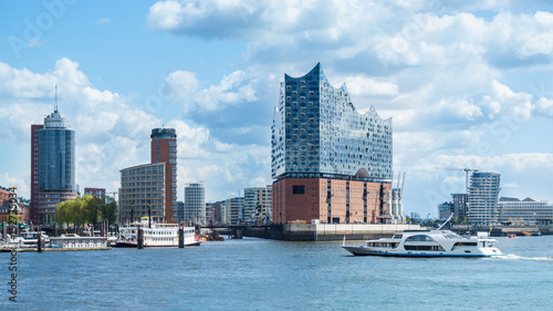 Photo sur Toile Europe Centrale Hamburg, elbphilharmonie and modern buildings with boat to the harbor tour