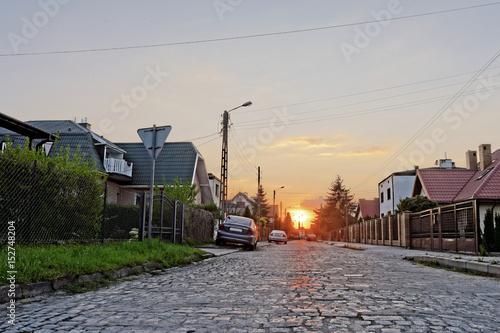 Fototapeta zachód słońca w mieście  obraz