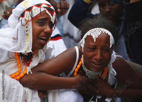 Women react at a protest during Irreecha, the thanksgiving