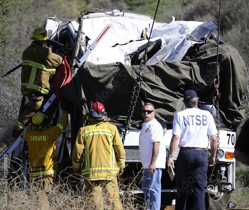 San Bernardino firefighters and investigators survey the