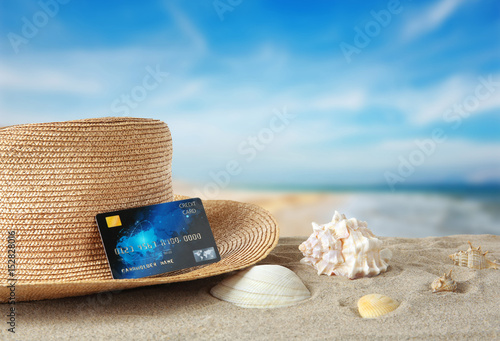 Fotografía  Sand with credit card and hat on white background