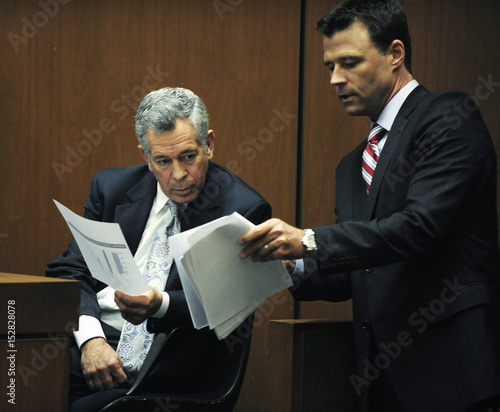 Deputy District Attorney David Walgren shows documents to