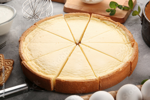 Tasty homemade cheesecake on grey table, closeup