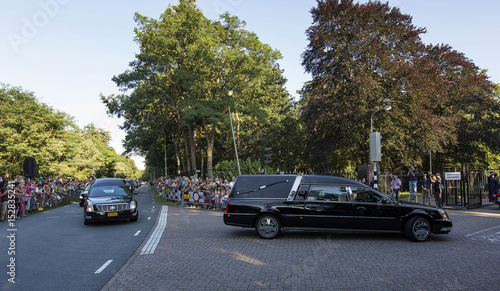 A row of hearses carrying the bodies of victims killed in