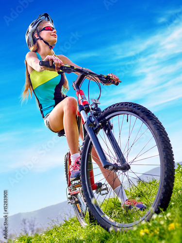 Aluminium Prints Cycling Woman traveling bicycle in summer park. Child road bike for running on green grass. Cycling trip is good for health. Happy cyclist in future.