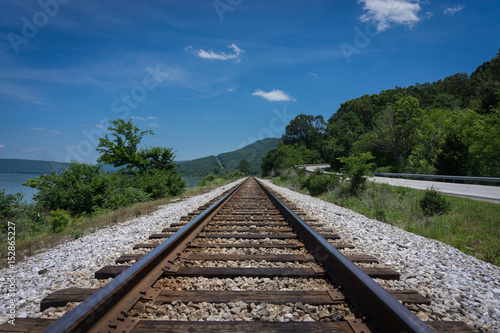 Fotografie, Obraz  Railroad Tracks leading to the Mountains