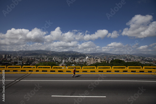 A man jogs on the Cota Mil, one of the city's main highways