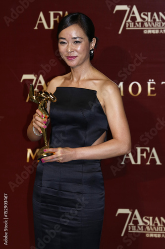 South Korean actress Choi poses with her trophy after
