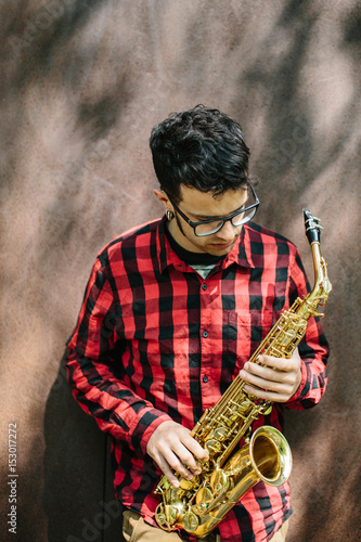 Young musician with sax Poster