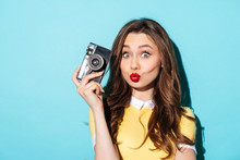 Portrait Of A Funny Girl In Dress Holding Vintage Camera