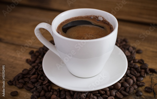 Foto op Canvas Chocolade cup of black coffee on wooden background