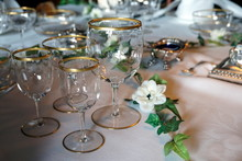 Antique Gold Rimmed Drinking Glasses On An Ornate Dining Table